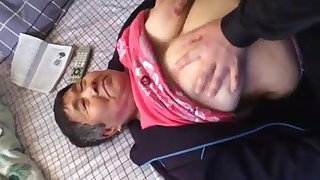Chinese Lady 70+ Gets Her Tits Worked